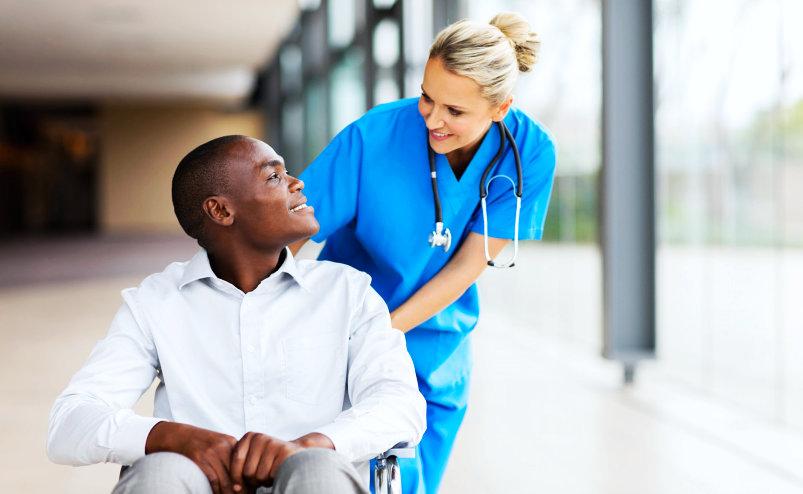nurse assisting the patient