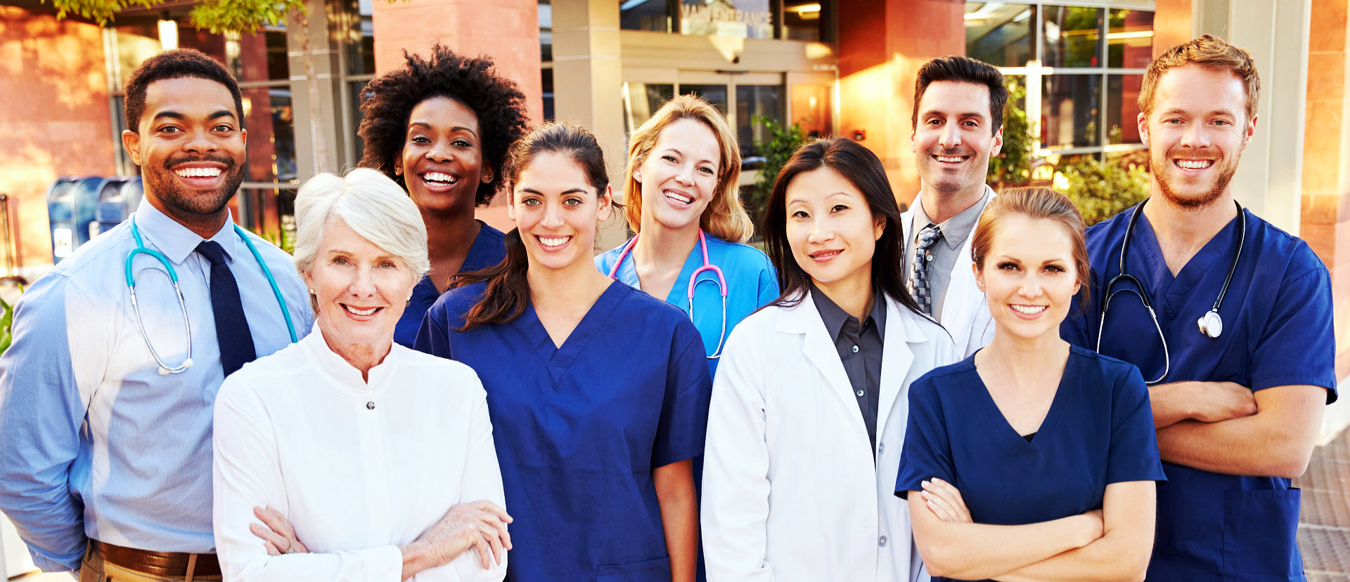 group of doctors and nurses smiling