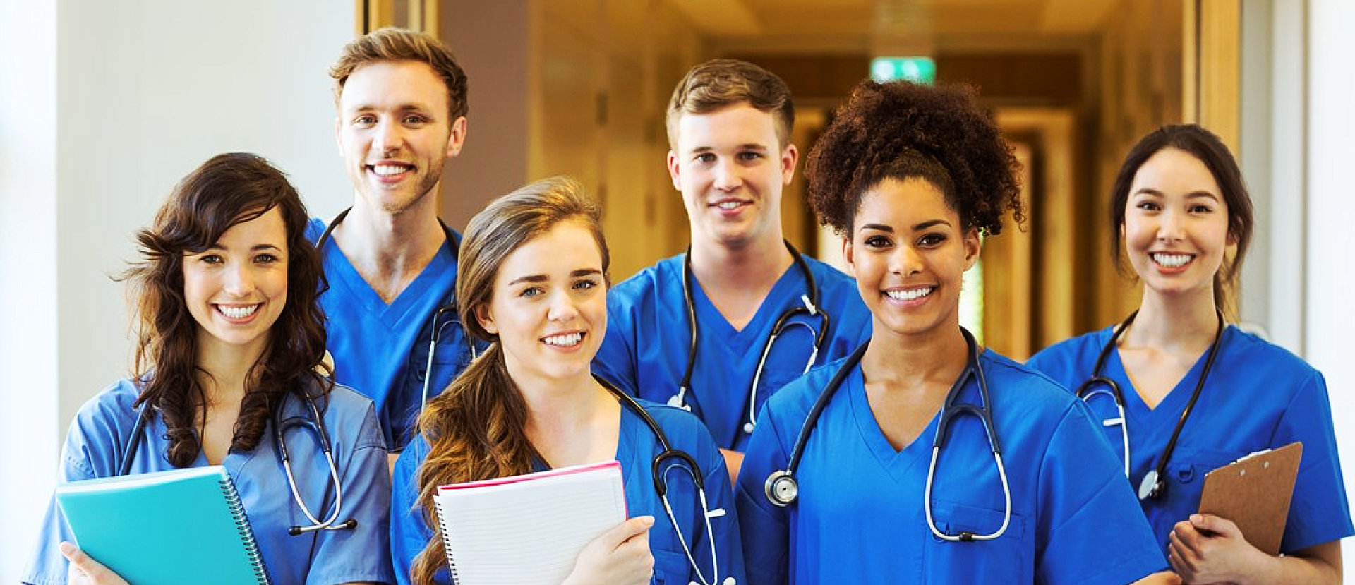 group of nurses smiling with clipboard