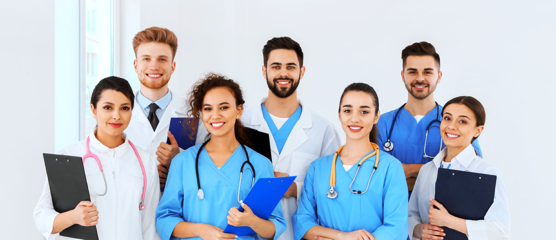 group of doctor and nurses smiling