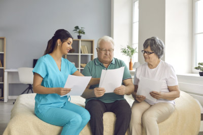 home care nurse helps senior patients fill informed exam consent
