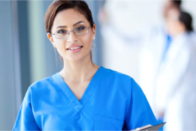 a nurse with glasses smiling