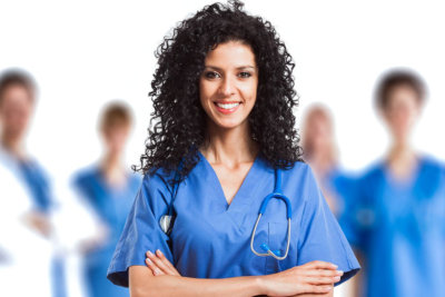 a nurse with collegues on the background