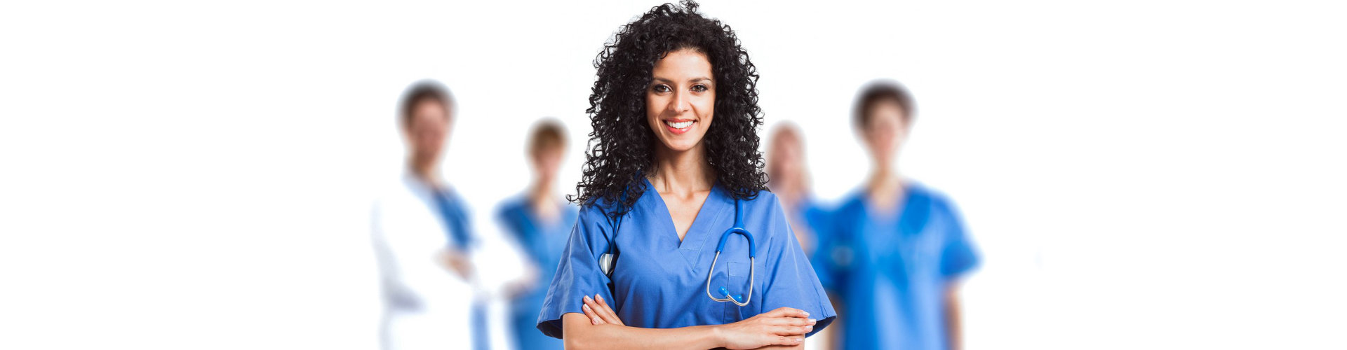a nurse with a curly hair smiling
